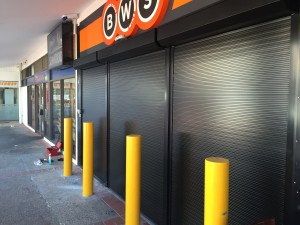 All three roller shutters engaged to provide optimal security to the buisness with a neat and presentable shop front.